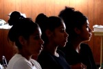 "Three young women listen to the testimony of Steven Payan, a Sacramento police-watch activist on the evening of Wednesday, July 21, 2010, at a community townhall meeting called by the Social Justice Coalition of Stockton , Modesto and Sacramento and dubbed ""Who Polices the Police?"" The event was hosted at the Nation of Islam Hall, downtown Stockton ."
