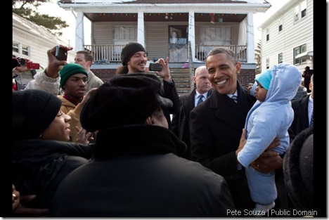 President Barack Obama greets neighbors outside the home of William and Endia Eason in Cleveland, Ohio, Jan. 4, 2012. The President visited the Easons, who almost lost their home after falling victim to a predatory lender, to discuss the need for a strong Consumer Financial Protection Bureau. (Official White House Photo by Pete Souza)