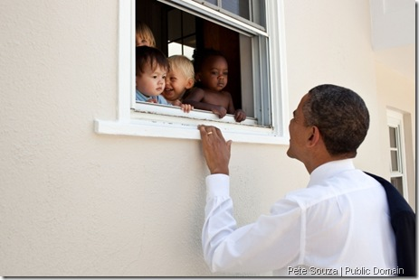 "June 9, 2011 ""The President had attended the fourth grade closing ceremony for his daughter Sasha at her school in Bethesda, Md. As he was departing, he noticed some pre-school children peering out of a window at a child care facility adjacent to the Sasha's school so he walked over to say hello to them."" (Official White House Photo by Pete Souza)"