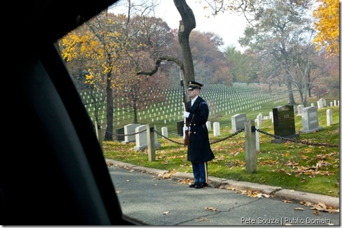 A soldier lines the road as President Barack Obama and First Lady Michelle Obama arrive at Arlington National Cemetery in Arlington, Va., to mark Veterans Day, Nov. 11, 2011. (Official White House Photo by Pete Souza)